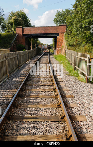 View along railway train tracks - Stock Photo