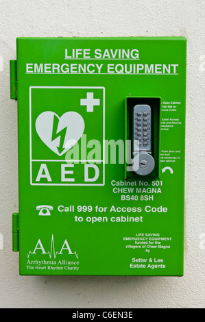Automated External Defibrillator in a locked cabinet in a public area - Stock Photo