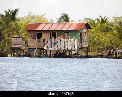 Amerindian native home over the water in Bocas Del Toro - Stock Photo