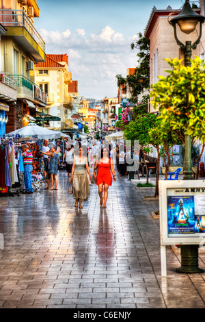 Argostoli capital of kefalonia, Greek Islands, Greece, main street of city, shops, shoppers, tourists shopping - Stock Photo