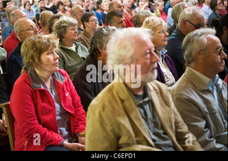 Audience listening to jazz concert in Brecon Cathedral during Brecon Jazz Festival 2011 - Stock Photo