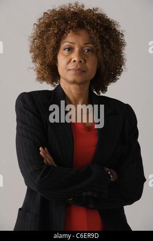Portrait of mature businesswoman, studio shot - Stock Photo