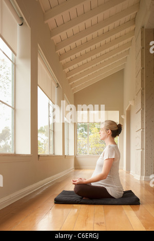 USA, California, Los Angeles, Beverly Hills, Pregnant woman practicing yoga - Stock Photo