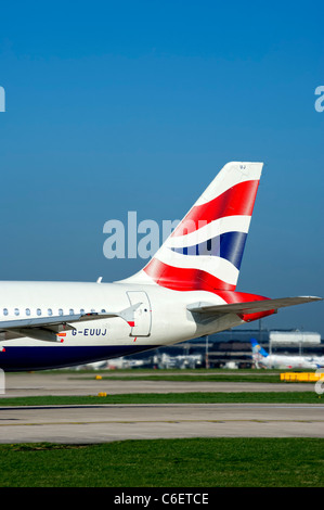 Tail fin of a British Airways aircraft showing their logo - Stock Photo