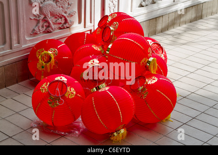 Chinese lanterns waiting to be hung in preparation for New Year. Bright red lanterns are hung all around the Tien - Stock Photo