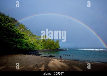 Rainbow, Kee Beach, Haena State park, Napali Coast, Kauai, Hawaii - Stock Photo