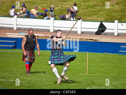 Competitor practising throwing the hammer, Scottish style, before competing in the Heavy Events at the Cowal Highland - Stock Photo