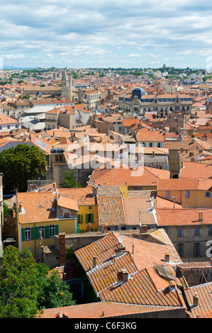 View of tiled rooftops and the town from the tower of the old cathedral in Beziers, France - Stock Photo