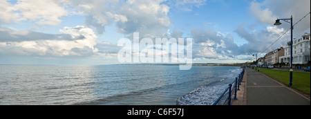 Filey promenade looking South towards the Chalk cliffs of Bempton and Flamborough, North Yorkshire. - Stock Photo