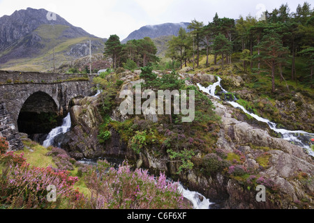 Waterfall by Pont Pen-y-benglog A5 road bridge over Afon Ogwen river in Snowdonia National Park Ogwen North Wales - Stock Photo