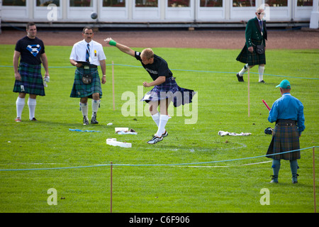 Kilted German Competitor Puts the Shot in the Heavy Events at the Cowal Highland Gathering 2011 - Stock Photo