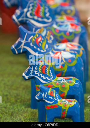 Colorful Dala Horses in a shop window in Stockholm, Sweden - Stock Photo