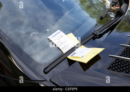 parking ticket on luxury mercedes car illegally parked on street in downtown winnipeg manitoba canada - Stock Photo