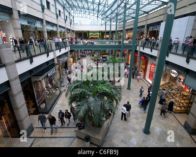 Interior of atrium in Centro one of Europe's largest shopping mall in Oberhausen Germany - Stock Photo