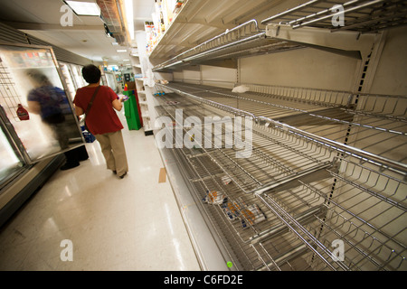 Bread shelves stripped bare of bread by customers stocking up for Hurricane Irene - Stock Photo