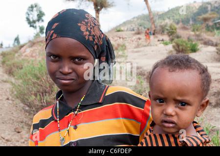 Portrait of Oromo children at a village in the Chercher  Mountains, Eastern  Highlands, Ethiopia, Africa. - Stock Photo