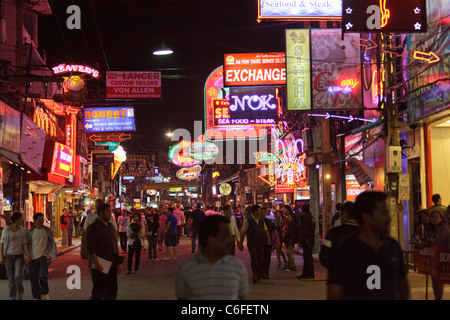 pattaya city walking street at night, many neon signs, banners for prostitution, Pattaya city, Thailand - Stock Photo