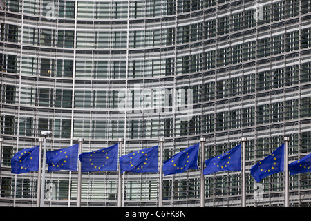 Flags wave outside the European Commission headquarters in Brussels. - Stock Photo