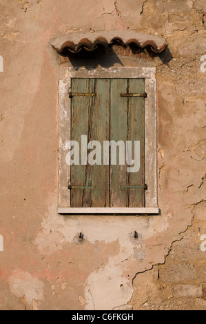 House window  door roof wall frame home old abandoned house closed building old cracks ruin restructuring clay tiles - Stock Photo