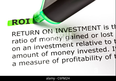 ROI (Return On Investment) highlighted in green with felt tip pen - Stock Photo