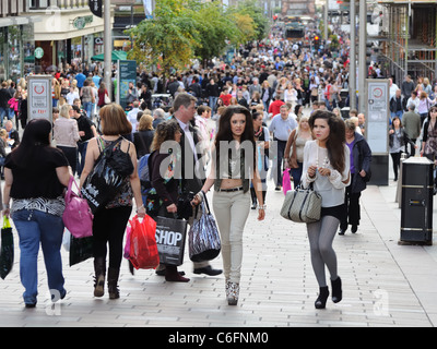 Busy street in Glasgow city centre Scotland. People shopping. - Stock Photo
