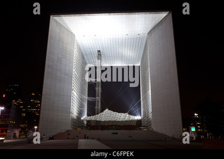 Night view of the Grand arch in the financial and business district of Paris - La Défense. - Stock Photo