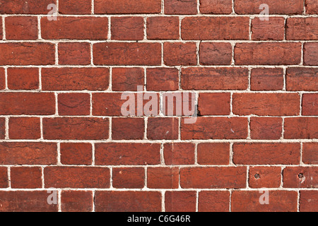 a red brick wall - Stock Photo