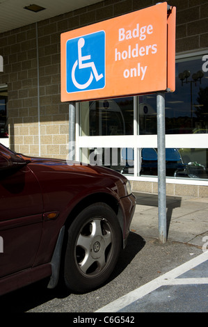 A car parked in blue badge disabled bay in a supermarket, uk - Stock Photo