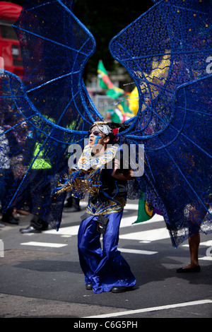 A dancer in a costume at the Notting Hill Carnival, London, England, UK, GB - Stock Photo