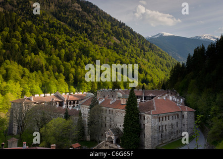 View of Rila Monastery, or the Monastery of St Ivan of Rila, in its setting in the Rila mountains, Bulgaria. - Stock Photo