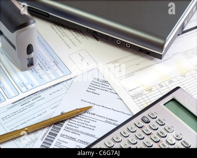 Accounting tools and bills on the table.
