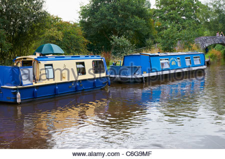 narrowboats moored on the monmouthshire and brecon canal in the brecon beacons national park - Stock Photo