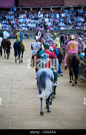 Palio di Siena 2011, July 2. Horse race: horses racing and historical parade. Piazza del Campo, Palio Siena. Editorial - Stock Photo
