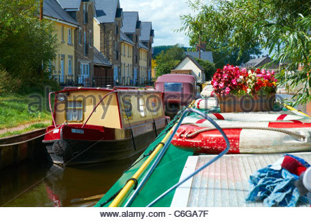 moored narrowboats on the monmouthshire and brecon canal in the brecon beacons national park - Stock Photo