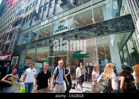 78f34cf3c9e6 ... Hordes of shoppers pass the newly reopened Lacoste store on Fifth Avenue  in Midtown Manhattan in