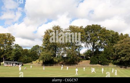 A Village Cricket Match in Derbyshire - Stock Photo