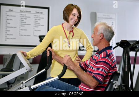 A physical therapist works with a patient in a hospital. - Stock Photo
