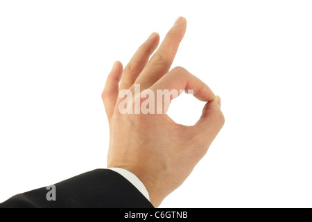 Business man's hand signing okay - Stock Photo