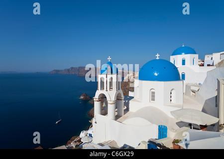 Blue domed churches in the village of Oia (La), Santorini (Thira), Cyclades Islands, Aegean Sea, Greece, Europe - Stock Photo