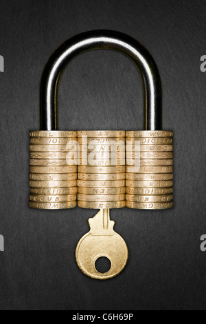 Padlock made form pound coins with a gold key inserted, signifying Financial Security - Stock Photo
