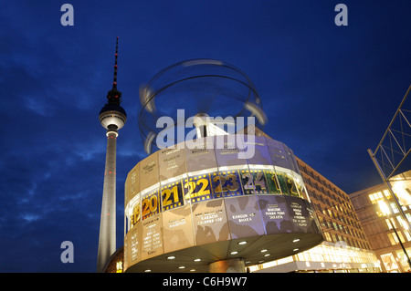 Famous World clock at Alexanderplatz with the TV tower by night, Berlin, Germany. - Stock Photo
