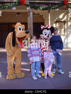 Children with Pluto and Minnie characters, Fantasyland, Disneyland, Anaheim, California, United States of America - Stock Photo