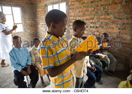 Young boys smartly dressed and singing at a church service - Stock Photo