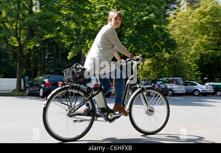 Girl riding on electric bicycle, pedelec, ebike, e-bike, Dortmund, Germany - Stock Photo