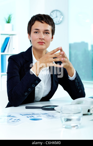 Photo of smart businesswoman sitting in office - Stock Photo