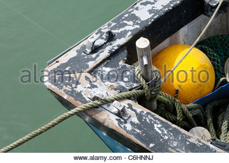 Top down view of a small fishing boat prow and float in Poole, Dorset, England, UK - Stock Photo