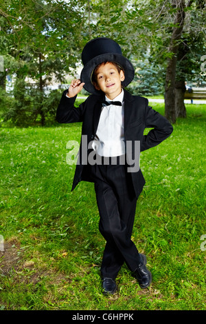 Portrait of boy groom looking at camera in the park - Stock Photo