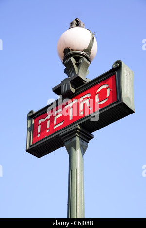 Paris metro sign and sky in the background  - Stock Photo