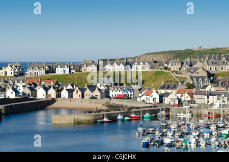 Findochty Harbour with gable ends and sailing vessels on fine day - Moray Coast - Stock Photo