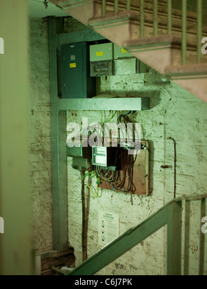 Collection of fuse box and electricity meters in an old building - Stock Photo